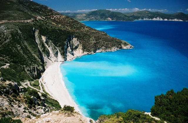 Last time I was in Greece, I visited Kefalonia, one of the Ionian islands of the coast of the mainland. And yes, the colors really are this vivid and the beach this spectacular.