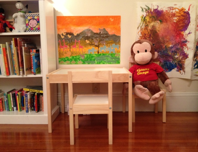 "George waits patiently for Baby on Baby's new <a href=""desk and table set."
