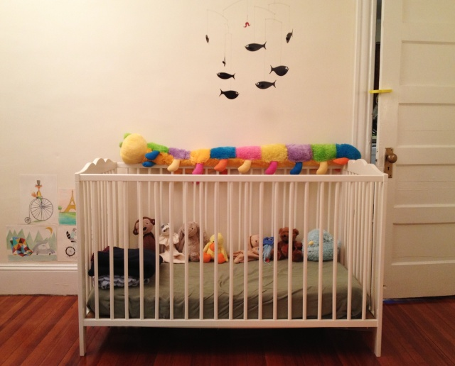 Baby's crib is from Ikea with a Flensted mobile from Baby's Hal-muh-nee.